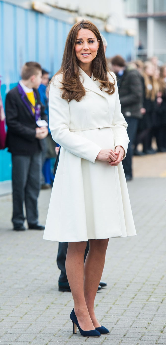 in February we saw her step out in this gorgeous white coat-style dress, which skirted out at the bottom to create a shapely sillhouette.