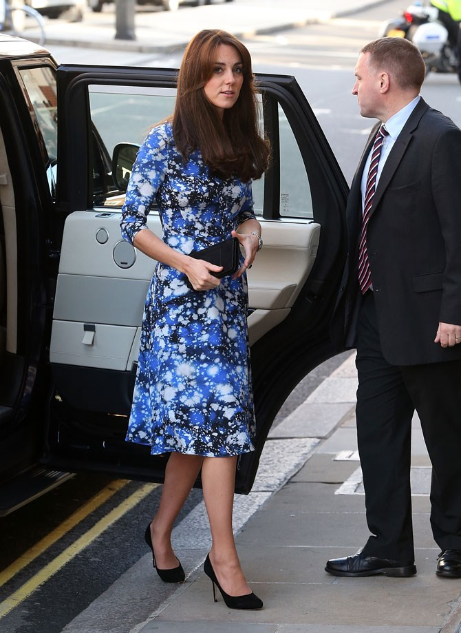 The print on this blue midi dress is a bit of an edgy change for the Duchess and we LIKE IT.
