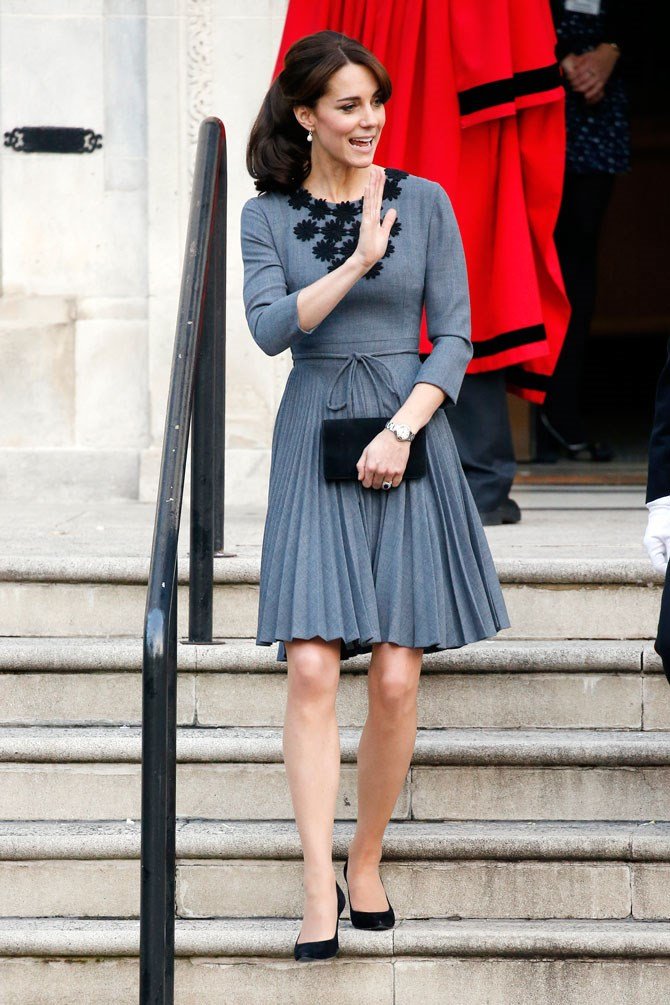 Keeping with the grey theme, but this time going for something a little heavier for her day time duties. Pleated skirts are a big hit this season, so she gets 10 points for being on trend.
