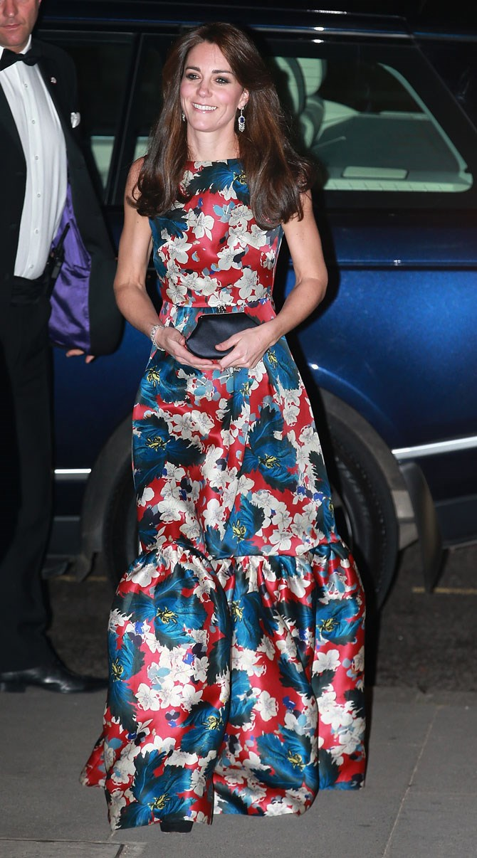 And for another night on the town (kinda) she absolutely rocked the socks off this red and blue floral, floor-length Erdem gown. We LOVE that dramatic, peplum style hem.