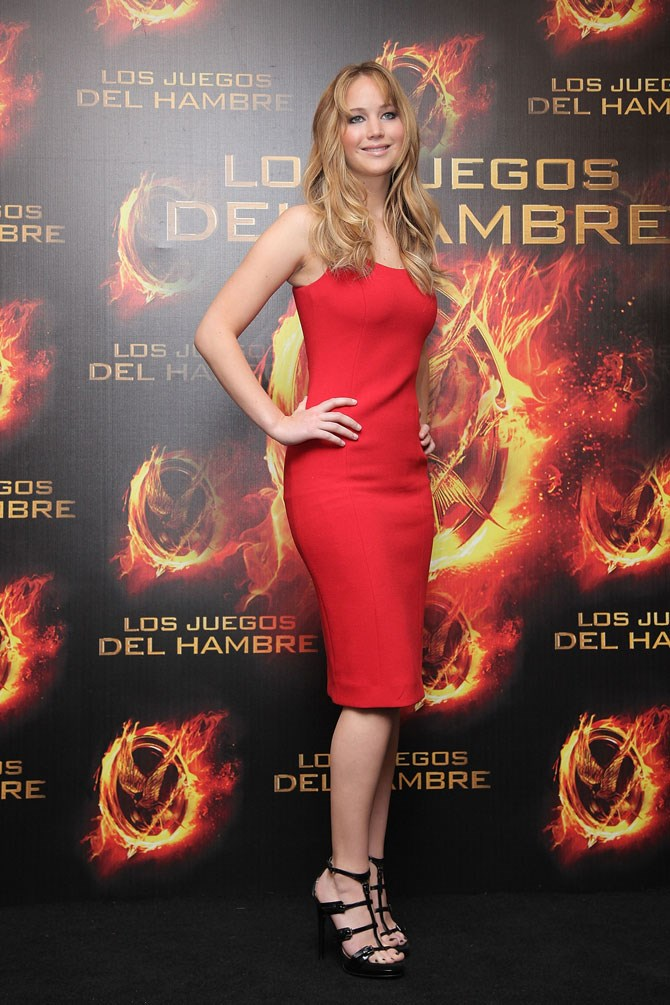 We know it might be hard to believe that there was ever a time where The Hunger Games didn't exist and Jennifer Lawrence wasn't our #GirlCrush. She's been attending the trilogy premieres for four whole years now and every time she has brought something different to the table, aesthetically speaking. Here, we look at The Hunger Games red carpet evolution of the one and only JLaw.    Starting with this simple red dress back in 2012 when she sported long hair and youthful bangs for the first ever photo call and press conference in Mexico.