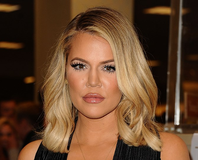 Khloé's new lob and hardcore contouring make her face look *seriously* sculpted. Like, does it do crunches to stay that tight?