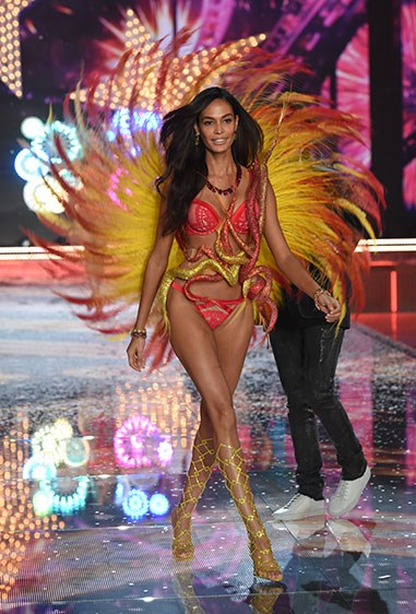 Joan Smalls is impossible to miss in this red and yellow flaming firework.