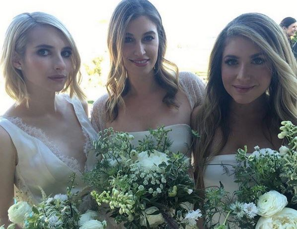 Emma Roberts looked stunning in ivory silk and lace, alongside 9 other bridesmaids over the weekend.