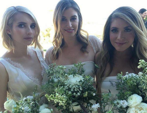 **Emma Roberts** <br><br> Emma Roberts looked stunning in ivory silk and lace, alongside nine other bridesmaids.