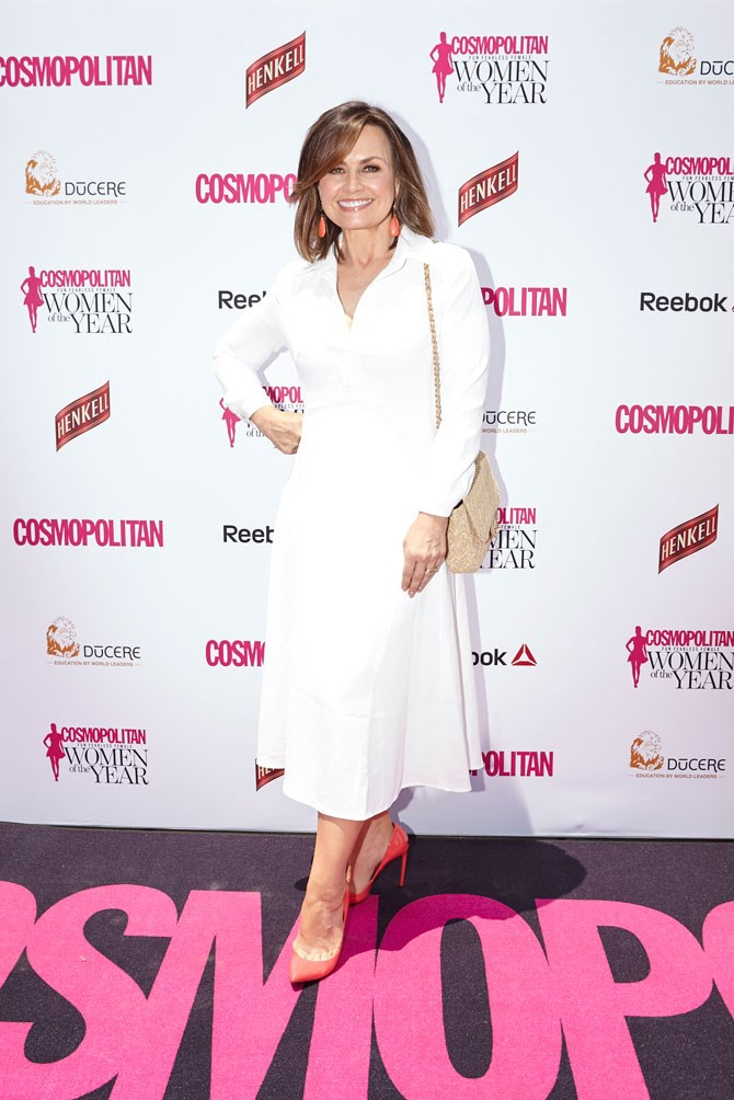 Lisa Wilkinson topped off her white midi dress with a bright pop of red on her feet.