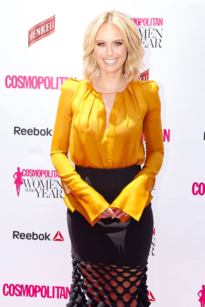 Sylvia Jeffreys looks INCRED (as always) in this stunning amber blouse teamed with a sexy black skirt.