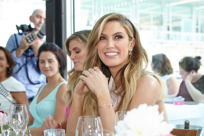 Delta Goodrem was all smiles and bare shoulders as she listened to some seriously tear-jerking speeches.