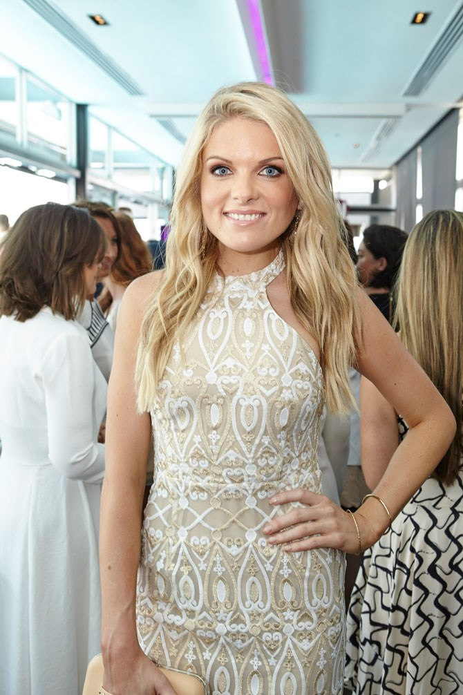 The Footy Show Host, Erin Molan, was a vision in nude, white and gold.