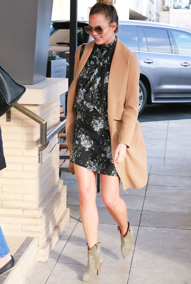 She stepped out for a bit of retail therapy in this floral mini, camel coat and chelsea boots. Who says you can't wear high necks when your boobs and belly are a growin'?