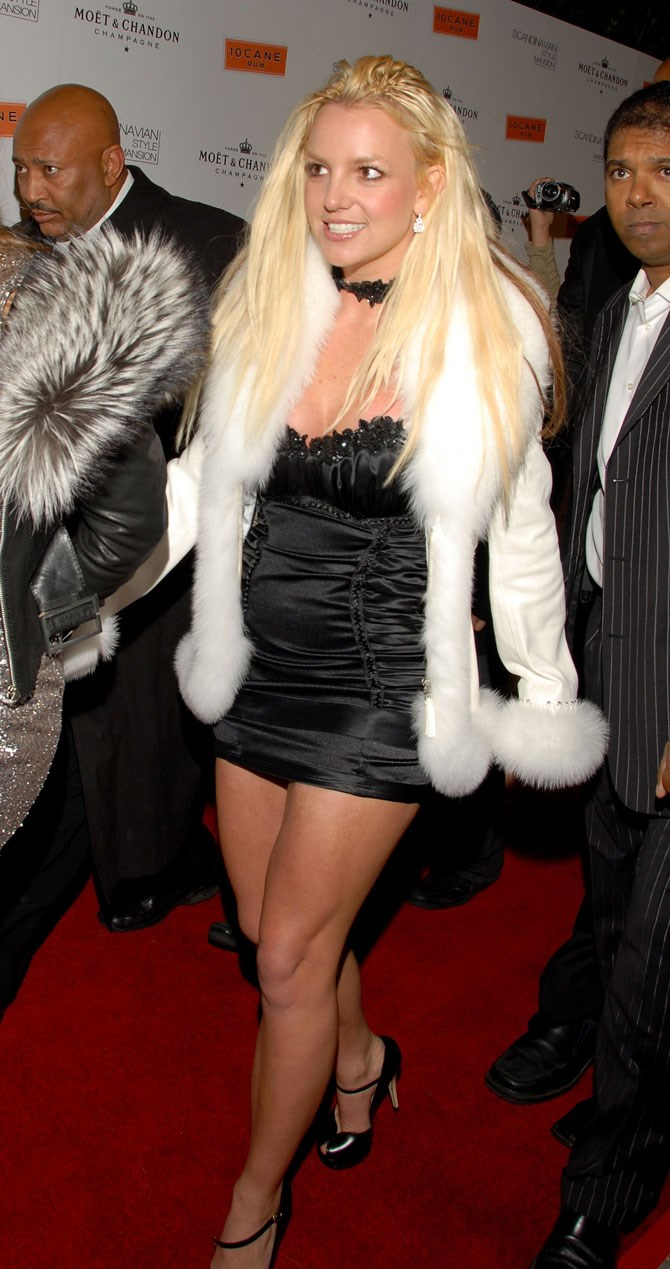 We could see the tracks in Britney's hair extensions for a good year or so post-shave. Do you think maybe the bad coat and tight mini dress was an attempt at distracting our eyes from her head?