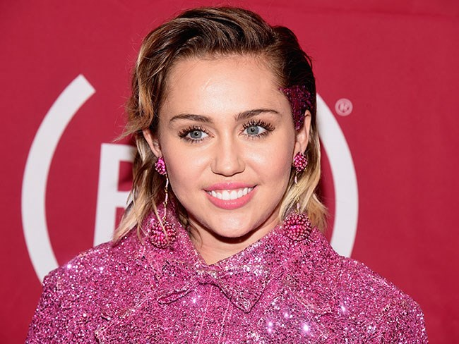 Miley Cyrus looks like her old self