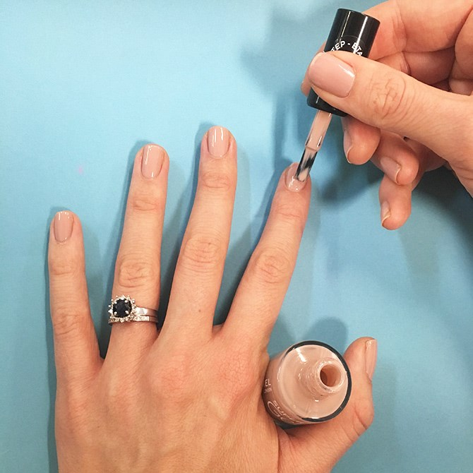 2. Apply one or two coats of Rimmel's Super Gel polish and then apply a top coat for a professional finish.