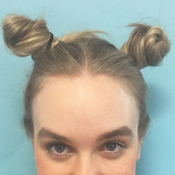 7. Sleep in twisted buns overnight and release them in the morning for bouncy waves.