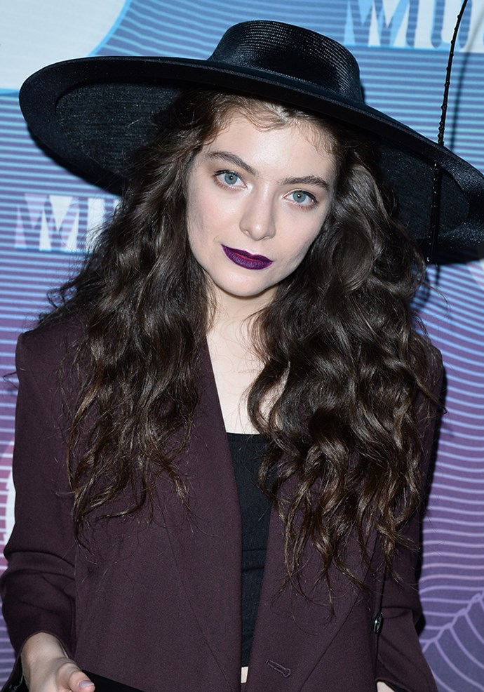 **Lorde** Known for her love of dark lips, Lorde collaborated with MAC on the lipstick shade Pure Heroine which looks killer against her creamy complexion. She's also a fan of the Make Up For Ever Rouge Artist Intense lipstick in in Satin Black – which is a tad cheaper, fyi!