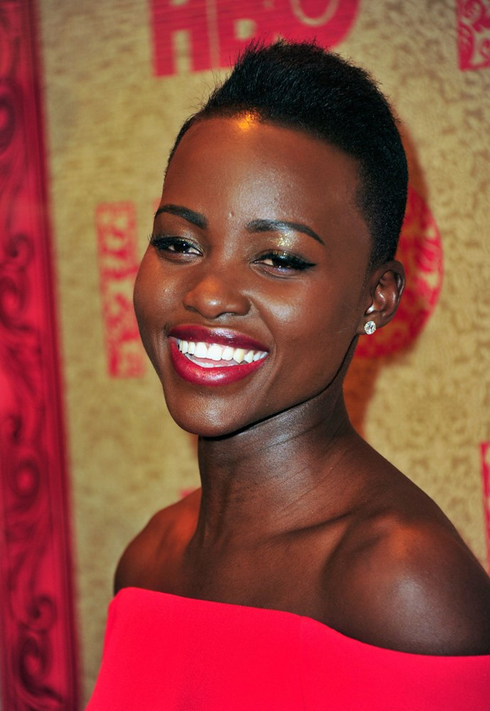 **Lupita Nyongo'o** Lupita's makeup is a constant inspiration. When she does hot lips, her shade of choice is the timeless YSL Rouge Pur Couture lipstick in #1 Le Rouge. It looks stunning on her.