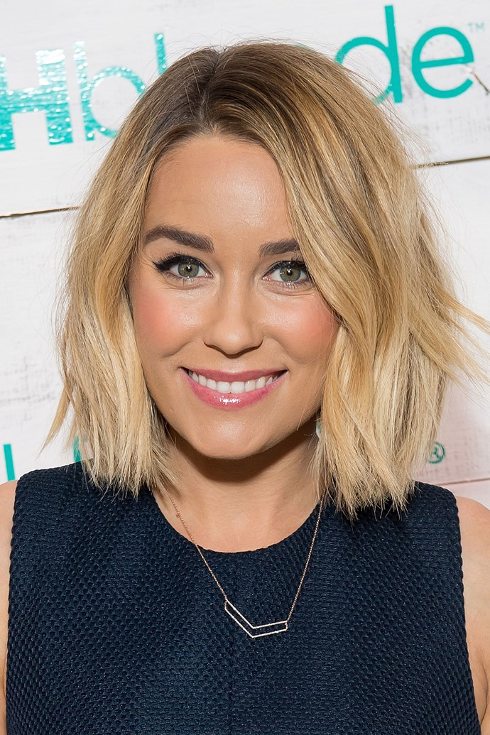 From *Laguna Beach* through to *The Hills* through to, well, always, Lauren Conrad has been the ultimate #HairGoals. So we KNOW you're gonna be more than interested to hear that her beach blonde is no more. This is not a drill: LC's gone full red head...