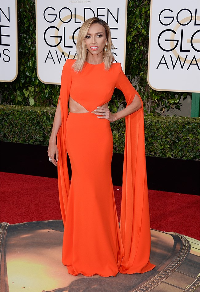 Giuliana Rancic is a tangerine dream in this wing-sleeved gown.