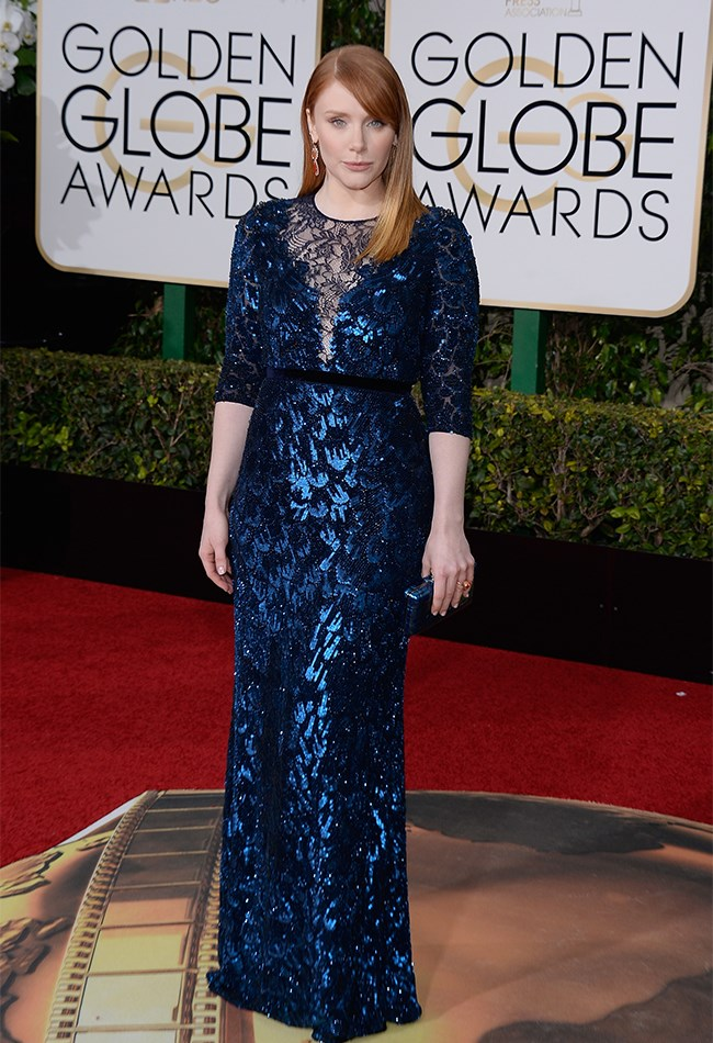 Bryce Dallas's metallic blue Jenny Peckham dress is giving us serious mermaid-vibes. We love that she has opted for a bright orange earring which really pops against the darker tones.