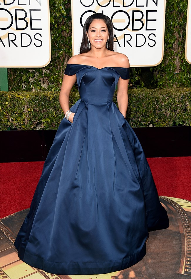 Gina Rodriguez looks like a real life princess in this very simple, yet very dramatic, navy blue Zac Posen gown.