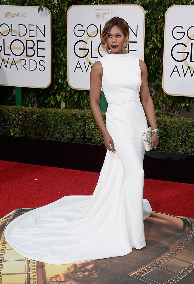 Lavern Cox looks crazy elegant in this white Elizabeth Kennedy gown with dramatic train. And you can never go wrong with emerald accents!