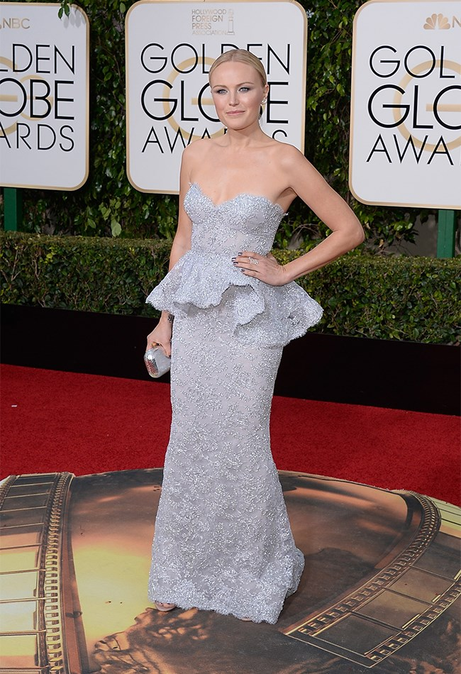Malin Akerma looks lovely in lavender by Reem Acra.