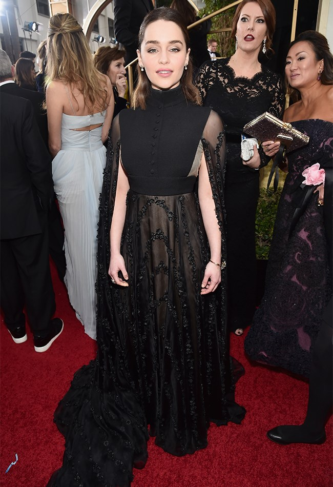 Emlia Clarke embraced the Victoriana trend for the red carpet, opting for black lace, a buttoned high-neck and dramatic cape. We love the look but just worried this Valentino gown is a little bit overpowering on her petite frame.