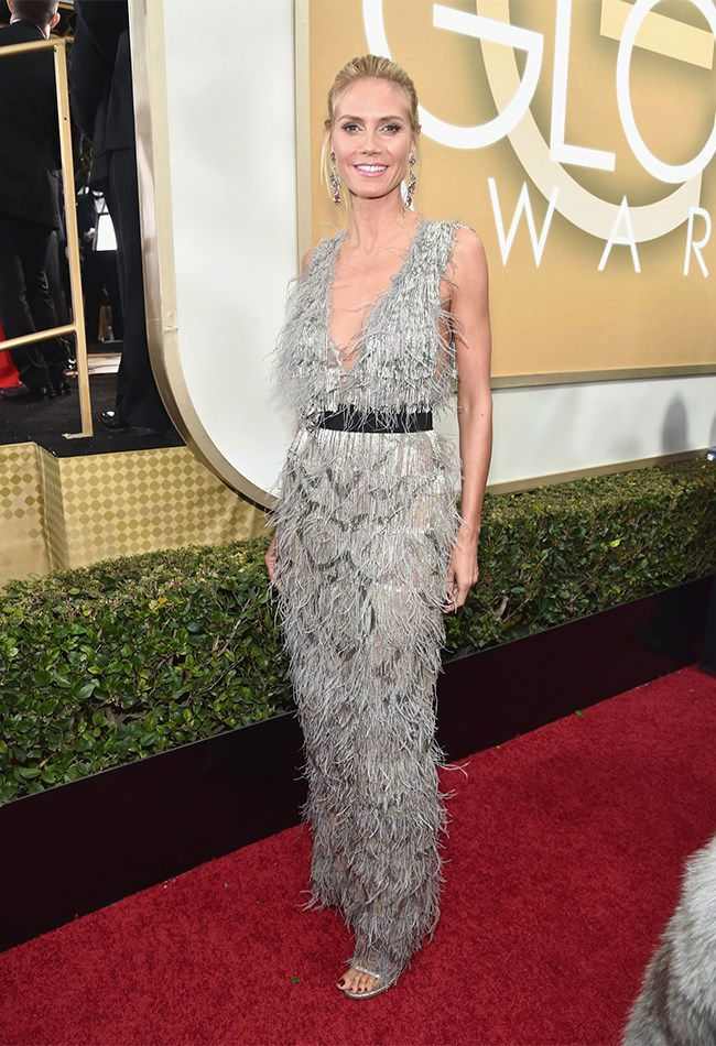 Like birds of a feather, Heidi Klum keeps it together.