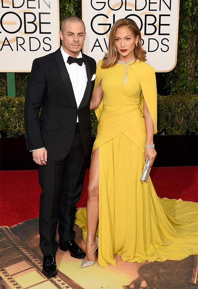 Jennifer Lopez also opted for canary yellow, surprisingly leaving her usual naked dress look at home. Her boyf Casper Smart looks pretty shmick by her side.