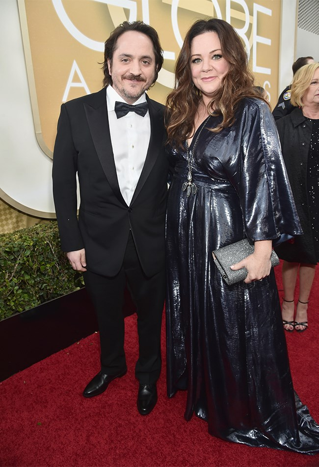 Melissa McCarthy and her hubby, Ben Falcone, look adorable together, as always. Getting oil spill vibes from Mel's dress though.