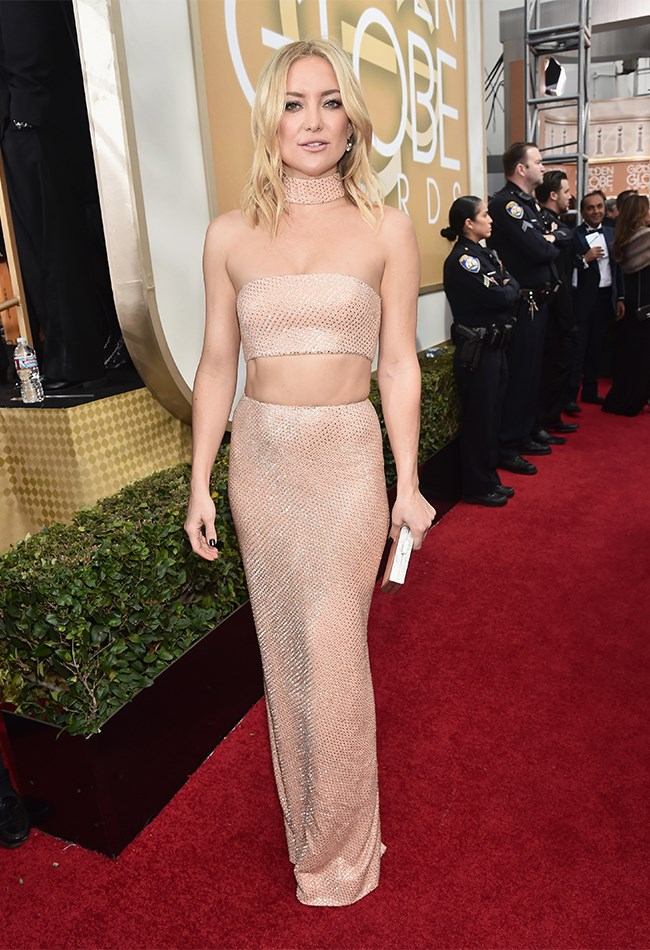 We get excited when Kate Hudson wears something other than white. We get REALLY excited when she wears a sparkly, nude Michael Kors crop top + skirt + choker situation.