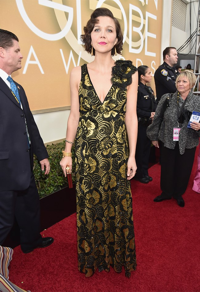 Maggie Gyllenhaal brought a little bit of black and gold Marc Jacobs to the table, and we have to admit, we likey.