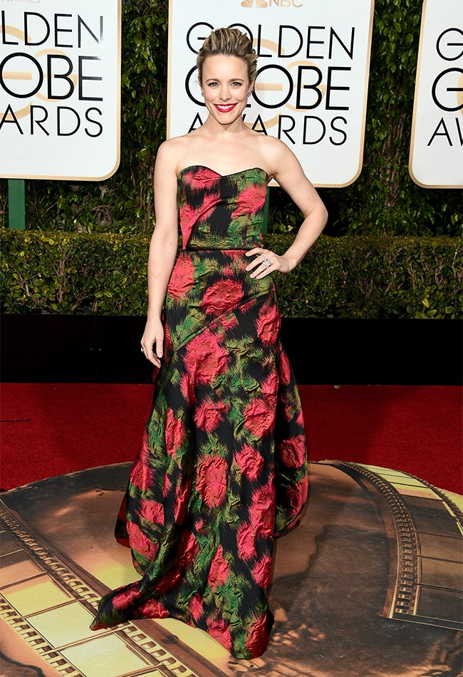 Rachel McAdams looks absolutely radiant in this rose-printed, strapless Lanvin gown.