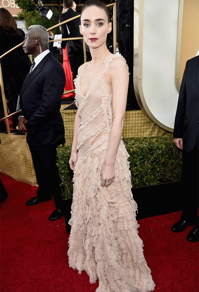 Rooney Mara also opted for a gothic look, but with a bit more of a 90's edge in this Alexander McQueen gown made from layers of torn, nude lace.