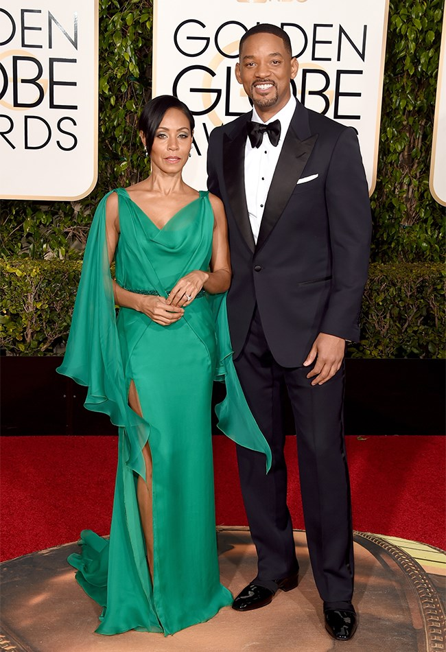 Jada Pinkett Smith also opted for a caped sleeve in this emerald green Versace gown. Hubby Will looks as handsome as ever.