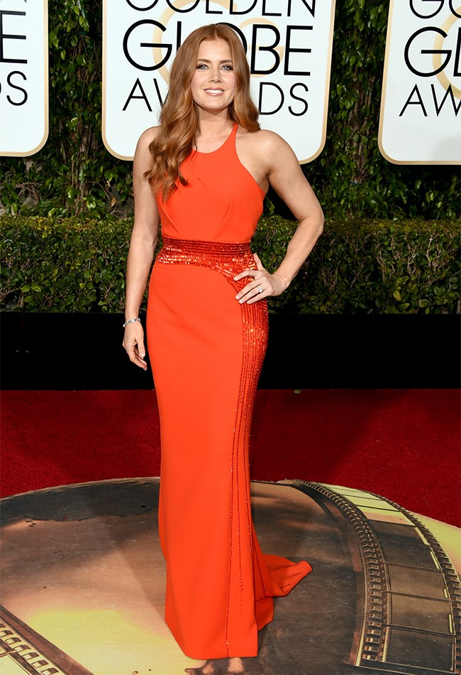 Amy Adams wowed in orange... but accompanied by her hair and her bad fake tan we're thinking it might be a little TOO much orange, if you know what we mean?