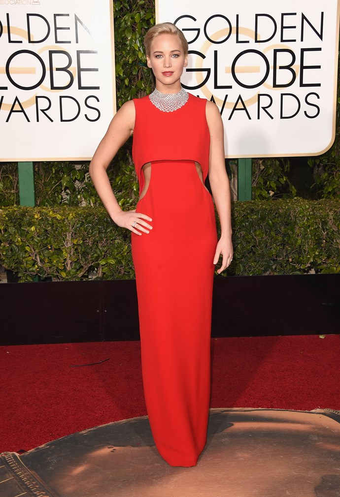 Jennifer Lawrence looks INCRED in this red Dior gown. We're loving the side cutouts which peak out beneath the structured top, creating a really interesting sillhouette.