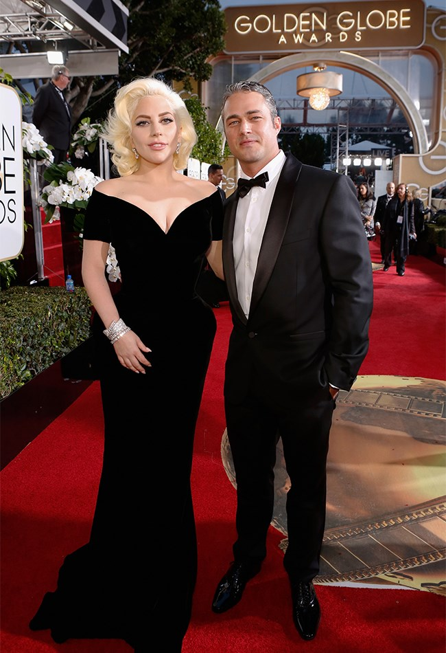 Lady gaga is PROPER old school Hollywood in this black Versace gown. That waist! Those hips! That Fiance!!! (Hi there, Taylor Kinney).