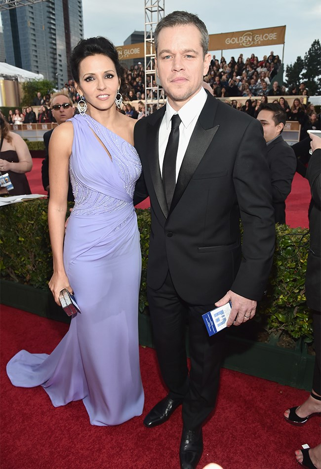 Matt Damon is a silver fox these days! His wife, Luciana Barroso looks stunning as always, but we're not into the purple Vegas-style dress.