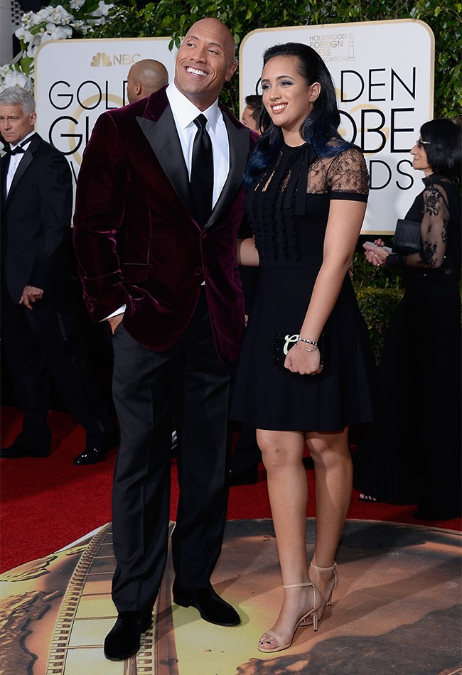 Cuteness overload as The Rock brings his daughter as his date. His velvet burgundy jacket gets major style points. Her daggy, nude kitten heels... not so much.