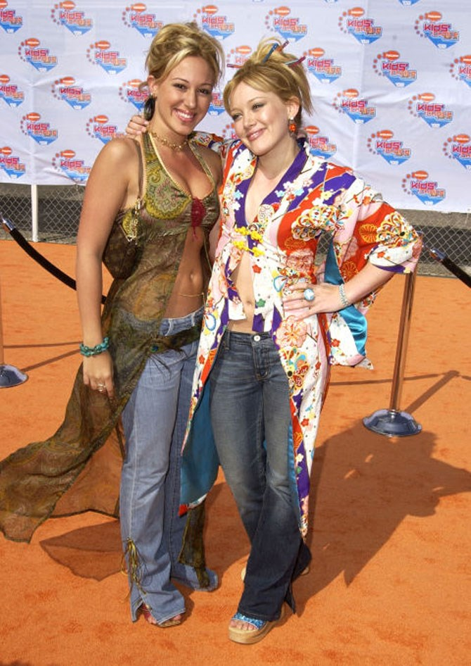 "**5. 2002, with Haylie Duff**    Oh my god, this was crazy. This is so embarrassing. Whenever I say I missed out on high school, everyone loves to tell me, ""You missed out on all the embarrassing things that happen."" And I'm like, ""Mine's documented for everyone to see,"" and that is the time where I wore a jewelled kimono with cut-out-hole sparkle platform shoes and about six chopsticks in my hair, and I thought it was the shit.    P.S.—check out my sister's tummy. I would kill for these abs right now. We shared clothes all the time. That would be like the only thing that we would fight about."