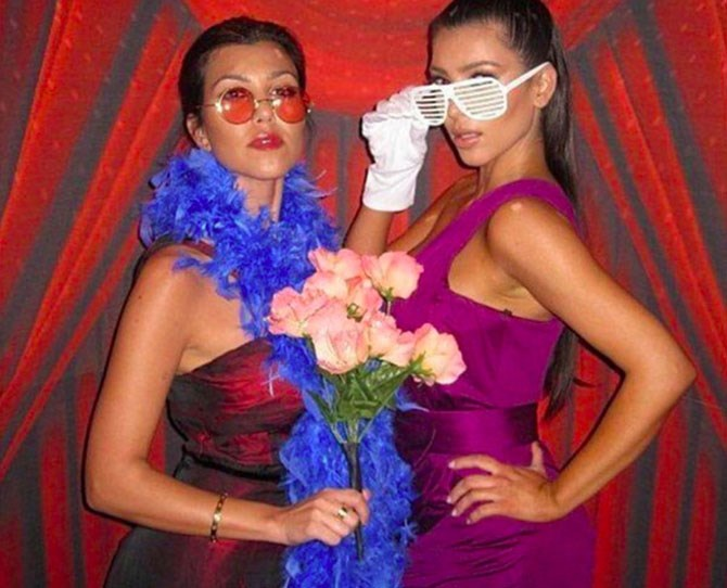"Kim and Kourtney circa 2008, featuring old-school Kanye shades and feather boas, [as shared by Kim](https://instagram.com/p/475tN6OS4a/?taken-by=kimkardashian|target=""_blank"")."