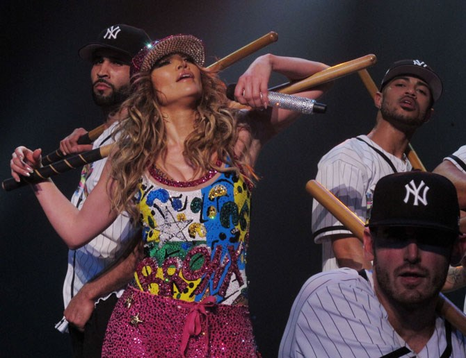 "The ""All I Have"" show not only saw JLo bust out the hits and the moves (oh, boy were there moves), but it also saw a plethora of next-level outfits worn by the diva.     Crystal embellished baseball caps and booty shorts never looked so good, especiallly surrounded by hot dancing baseball men."