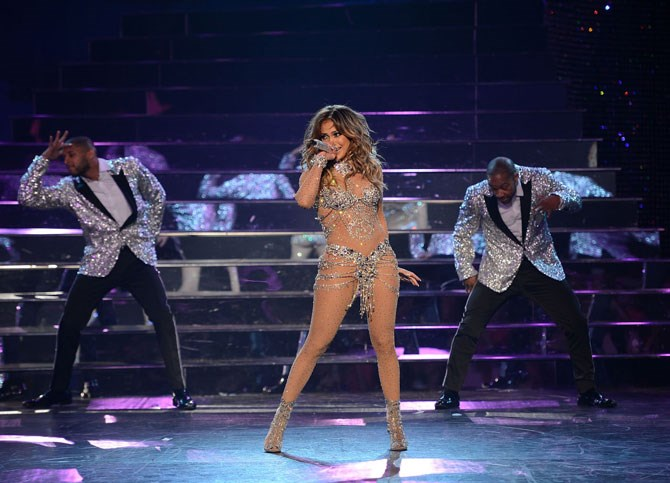 Collectively, there were a total of 260,000 Swarovski crystals used to help JLo sparkle the audience into oblivion, with many of the costumes custom designed by Versace.