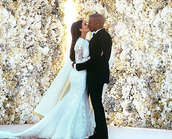 **2.41 million likes** A simple heart emoticon was all Kim Kardashian West captioned her stunning wedding shot with but really with a dress, groom and a flower wall like that, what more did she really need?