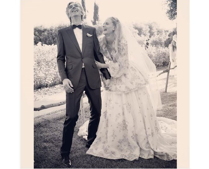**32,200 likes** Poppy Delevingne posted this adorable throwback to her special day, captioned 'Having zero fun on our wedding day. @cook_james'. Yeah…looks like it!