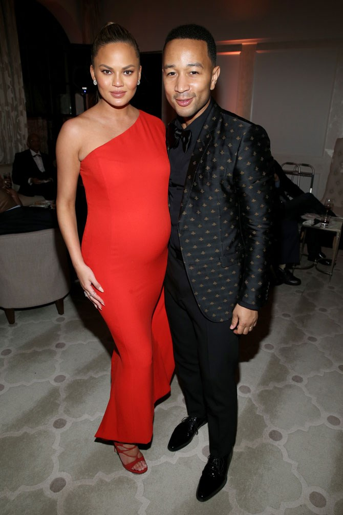 How this woman stays out so late when pregnant without falling asleep standing up we will never know. But let us just focus on the incredibly chic, one-shouldered gown that she wore to the after party shall we? Hubby John is still her best accessory, though.