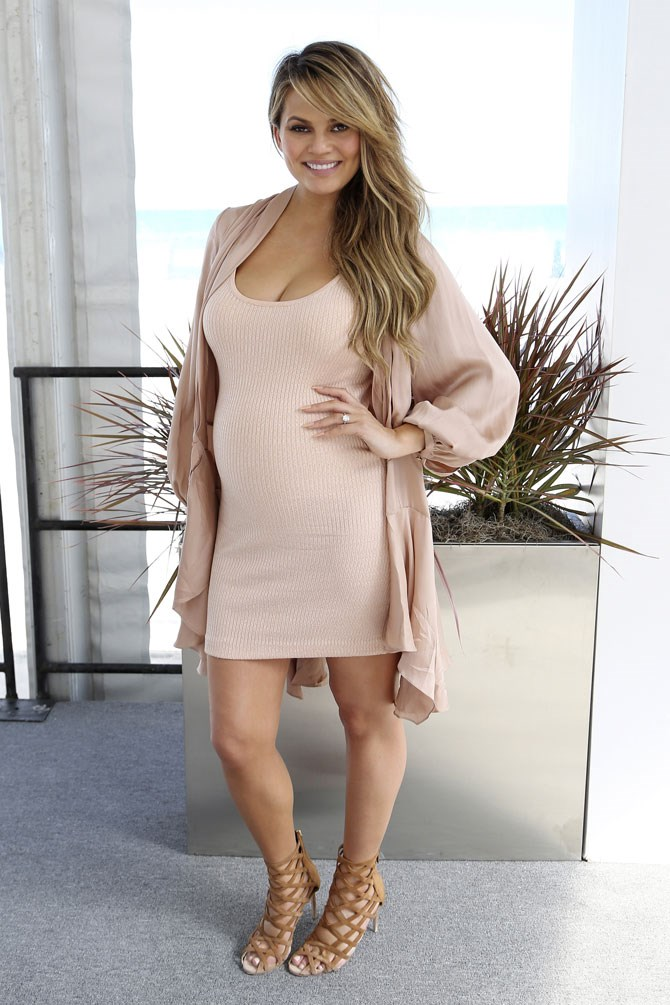 Chrissy looked incredible in blush tones as she attended a Sports Illustrated event in Miami for the swimsuit issue.
