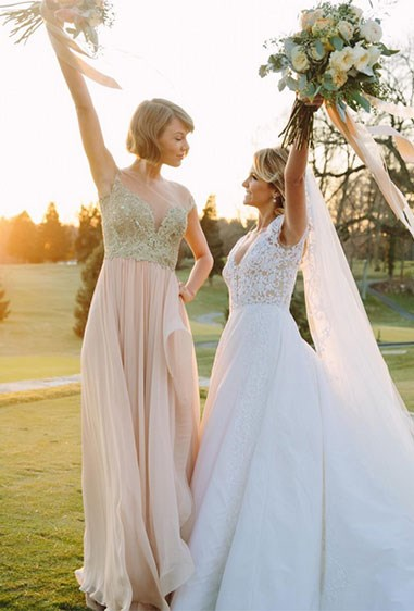 """Taylor Swift was maid of honour for her best friend, Britany Maack. She looked amaze in a nude off the shoulder dress and loose waves as she carried her Best friend veil in front of family and friends. """"This is my first time, and it's really, really important to me because this is my best friend, who I've known since I was born,"""" she told People magazine. Cute."""