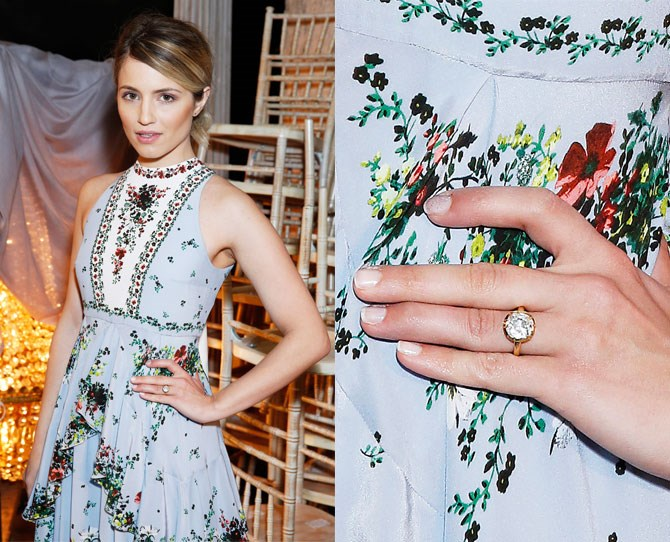 Former *Glee* star, Dianna Agron, got engaged to Mumford and Sons' Winston Marshall over the Christmas break, but no one had ACTUALLY confirmed it... until now!    Agron stepped out for the Erdem show at London Fashion Week on Monday and she was flashing one hell of a pretty diamond. Bezzle-set in yellow gold, the diamond looks to be somewhere between 4 to 6 carats, making it almost impossible to hide as she sat front row.